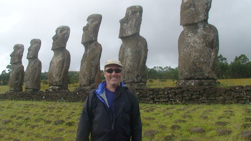Gary standing by ancient statues.