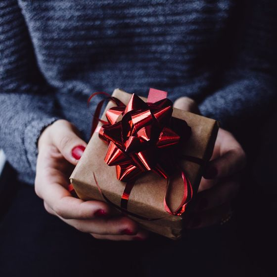 Picture of 2 hands holding a wrapped gift